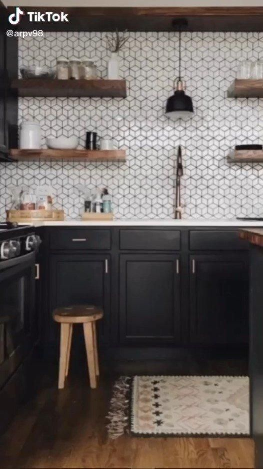 Darker kitchen cupboards and walls are finally in after years of a stale white stranglehold.