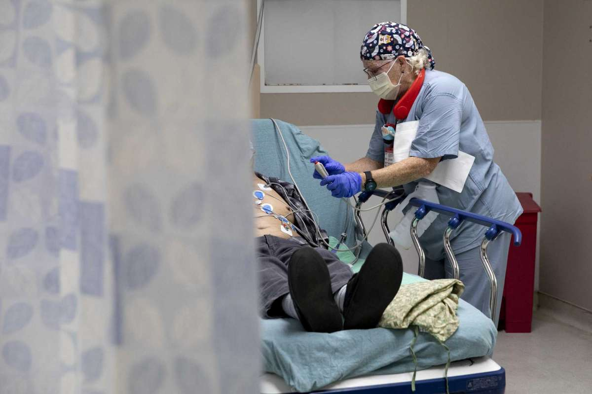 Juli Winters is a housekeeper at Texas Vista Medical Center, but she often ends up helping patients when nurses are slammed with COVID-19 patients.
